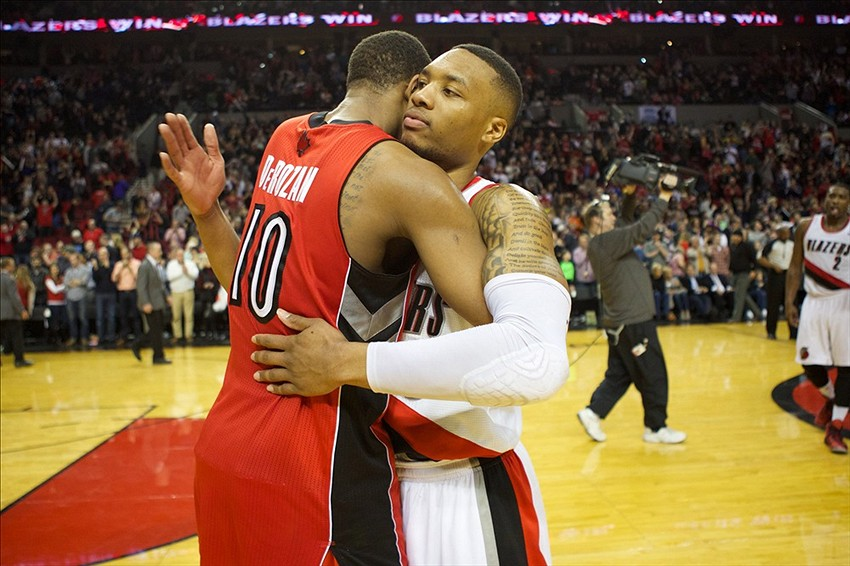 DeMar DeRozan awkwardly hugging it out with Damian Lillard