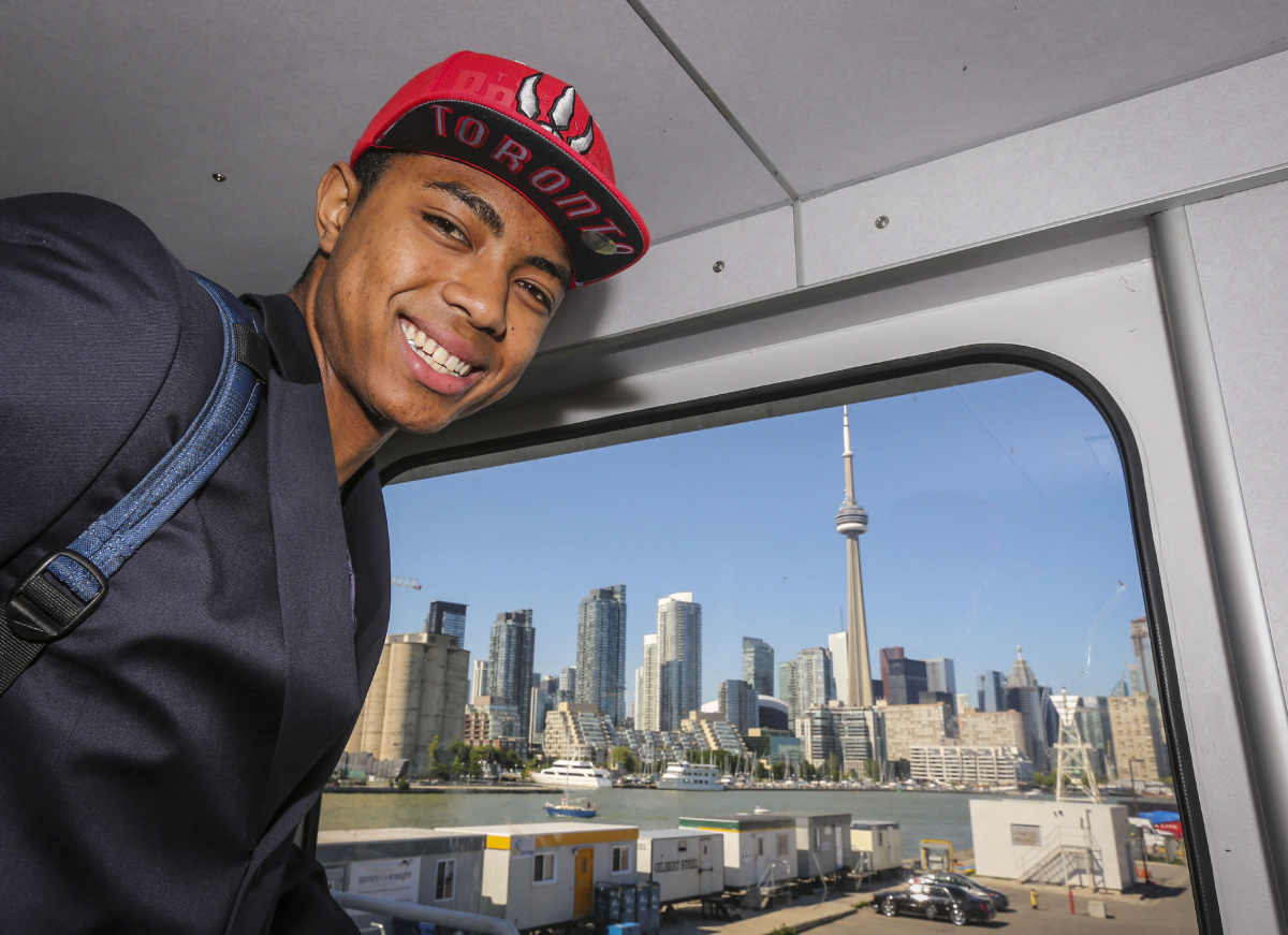 Brazilian Basketball player Bruno Caboclo drafted 20th over all by the Raptors arrives on Porter Airlines  from Newark NJ at Billy Bishop Airport in Toronto. Toronto Star reporter Isabel Teotonio (in Red) talks to Bruno as he arrived.