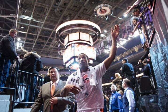 Toronto Raptors' DeMar DeRozan waves to the crowd as he leaves the court following his team's 100-84 win over Philadelphia 76ers in an NBA basketball game, Wednesday, Jan. 14, 2015 Toronto. (AP Photo/The Canadian Press, Chris Young)