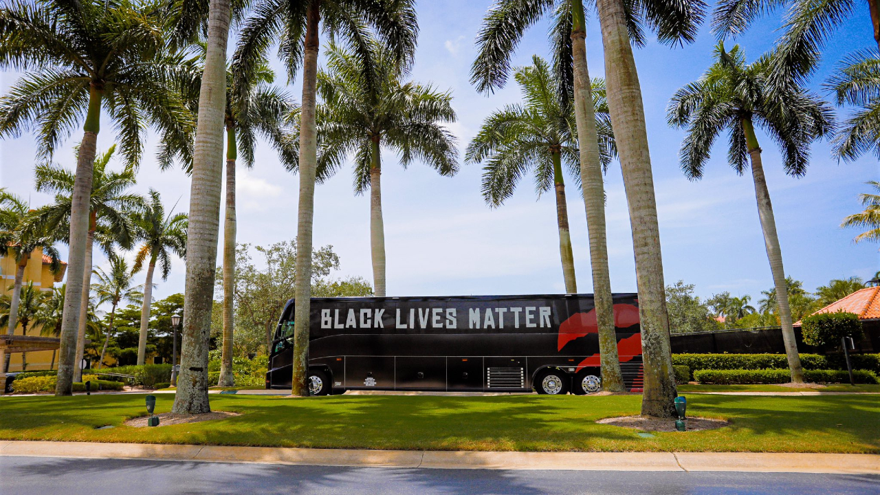 The Toronto Raptors team bus emblazoned with the words'Black Lives Matter' drives through Florida